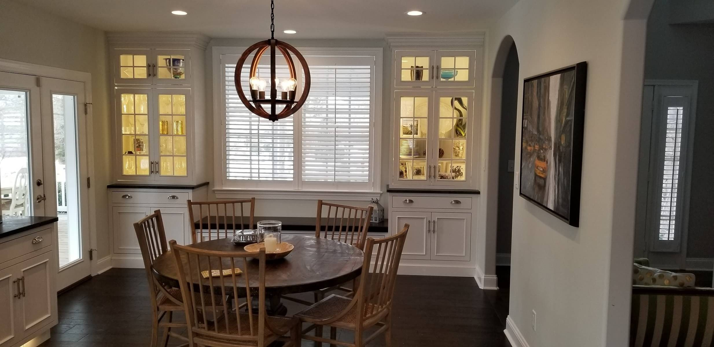 Eat in kitchen with glass door cabinets and window bench
