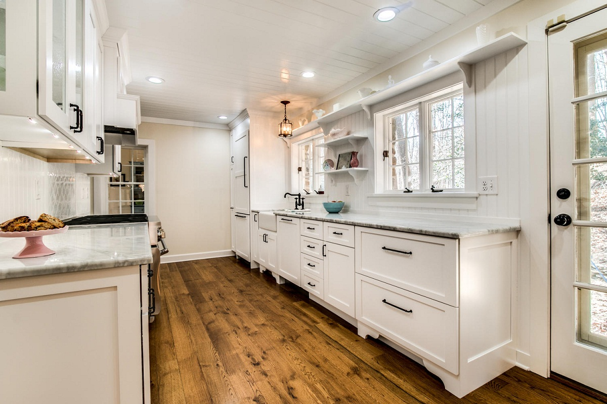 White farmhouse kitchen with natural wood floors